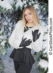 Portrait of a cute woman posing in winter
