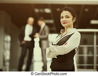 Portrait of a cute young business woman smiling, an office environment