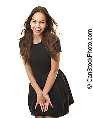 Portrait of a cute young woman laughing in black dress