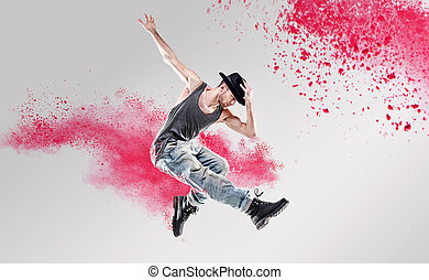 Portrait of a dancer excercising among a colorful dust -...