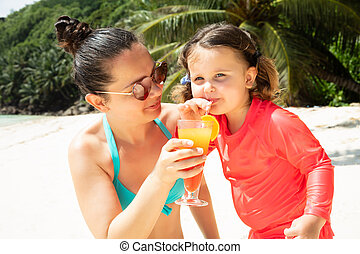 Daughter Drinking The Juice From Glass