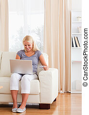Portrait of a delighted woman shopping online