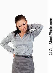 Portrait of a depressed businesswoman having back pain