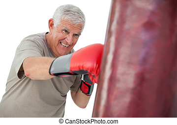 Portrait of a determined senior boxer over white background