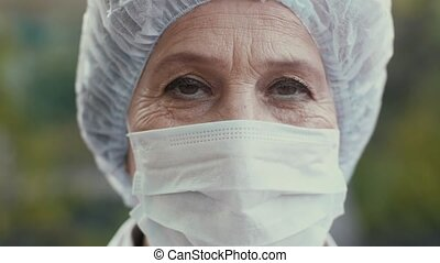 Portrait of a Doctor at surgical mask - Woman wearing...