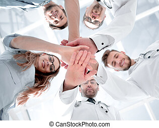 Portrait of a doctor team connecting hands stacking