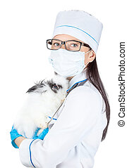 portrait of a doctor with a decorative rabbit in hands