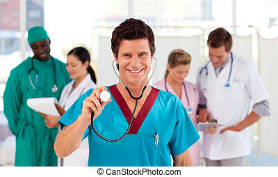 Portrait of a doctor with his team in the background