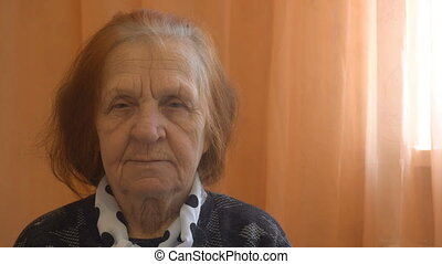 portrait of a elderly woman looking at the camera