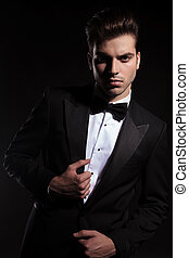 elegant business man looking at the camera