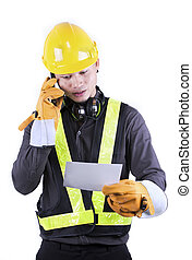Portrait of a engineer talking on the phone