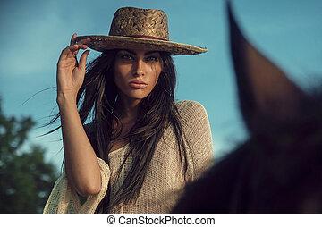 Portrait of a fabulous modelm riding a horse