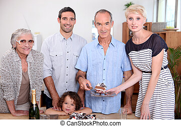 portrait of a family at birthday party