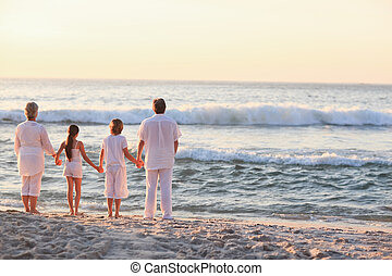 Portrait of a family beside the sea