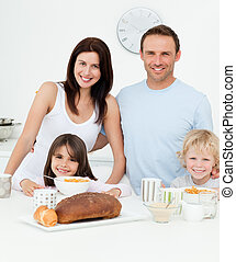 Portrait of a family having breakfast together in the kitchen