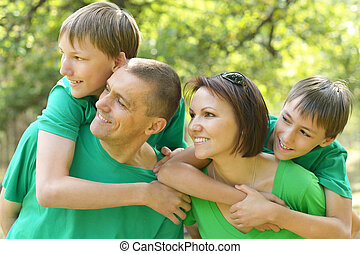 Portrait of a family  in summer
