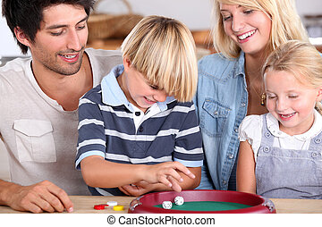 portrait of a family playing games