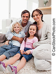 Portrait of a family relaxing in their living room