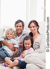 Portrait of a family relaxing on a sofa