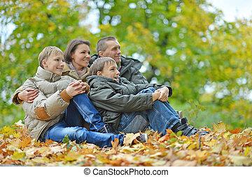 sitting in autumn park