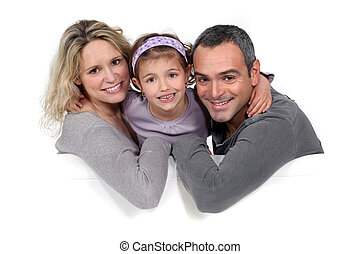 Portrait of a family sitting on a sofa