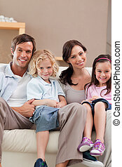 Portrait of a family watching television together