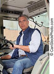 portrait of a farmer in tractor