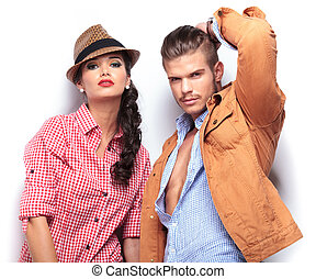 fashion young couple looking at the camera