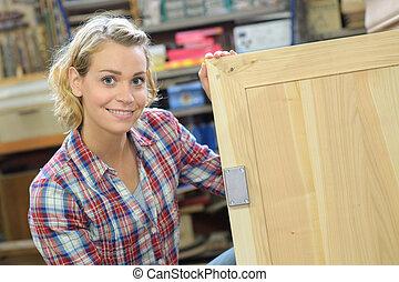 portrait of a female carpenter