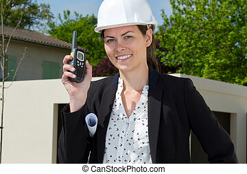 portrait of a female contractor in construction site