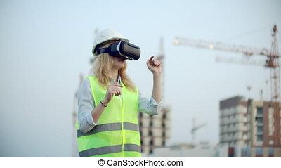 Portrait of a female crane operator operating a construction...