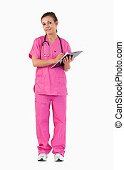 Portrait of a female doctor taking notes