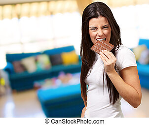 Portrait Of A Female Eating Chocolate