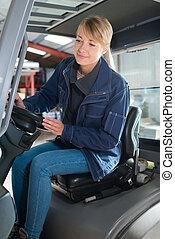 portrait of a female forklift operator