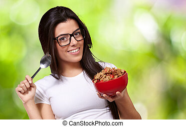 Portrait Of A Female Holding A Breakfast Bowl