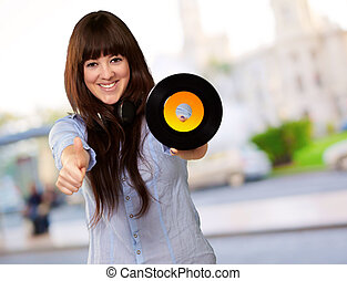 Portrait Of A Female Holding A Disc