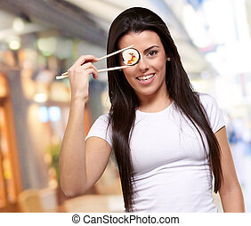 Portrait Of A Female Holding Sushi Roll