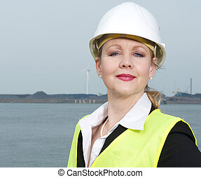 Portrait of a female industry inspector in hard had and safety vest