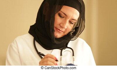 portrait of a female muslim doctor