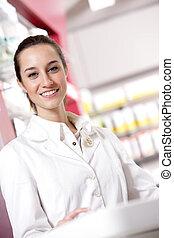 portrait of a female pharmacist at pharmacy