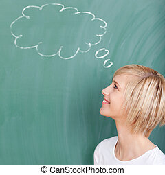 student with speech bubble on chalkboard