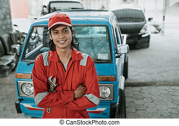 portrait of a female technician with broken car