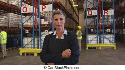 Portrait of a female warehouse manager at work 4k