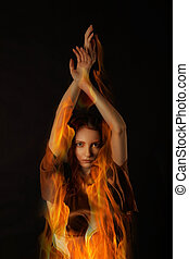 Portrait of a Fire Woman on black background