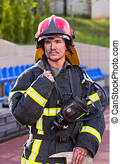 Portrait of a fireman with an axe - Portrait of heroic...