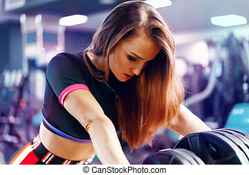 Portrait of a fit woman gym trainer