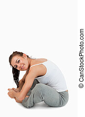Portrait of a fit woman stretching her legs
