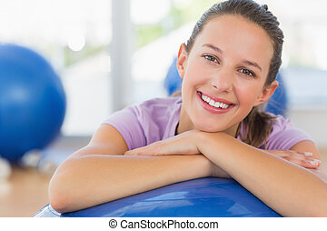 Portrait of a fit woman with exercise ball