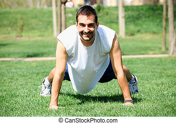 Portrait of a fitness man doing push ups