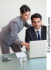 Portrait of a focused business team working with a laptop